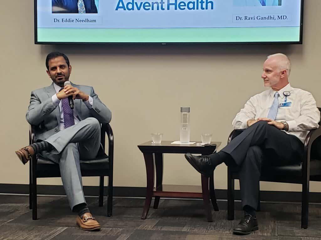 Dr. Ravi Gandhi and Dr. Eddie Needham speak during National Stroke Awareness Month event in May