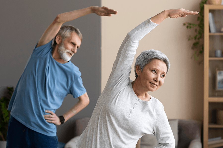 An older couple exercises