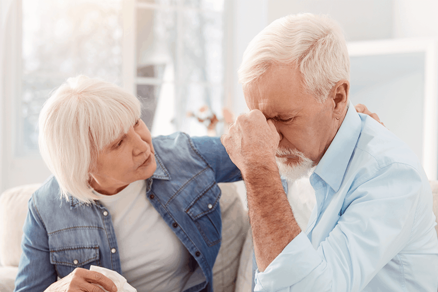 Older woman recognizes signs of stroke in an older man